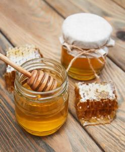 Jars of honey on a old wooden background