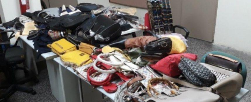 PIETRASANTA – lotta alla contraffazione, nascondevano merce contraffatta nella vegetazione